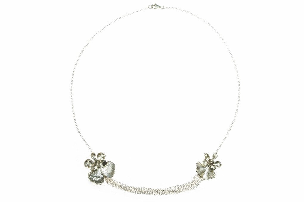 ROC's Double Orchid Necklace, made by dipping two mini orchids in fine silver.
