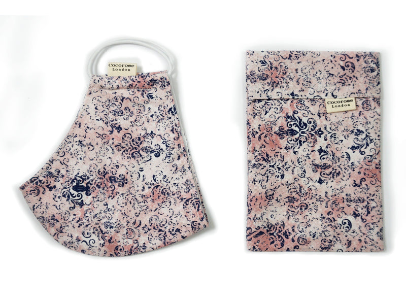 Blush pink and navy print face mask with matching storage pouch