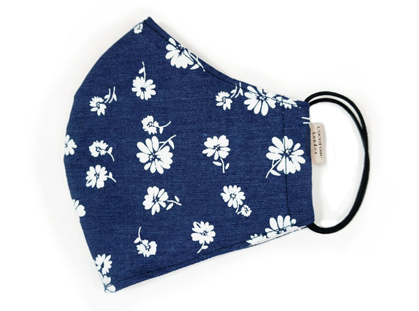 navy cotton face mask with filter pocket and adjustable elastic loops with white flower print