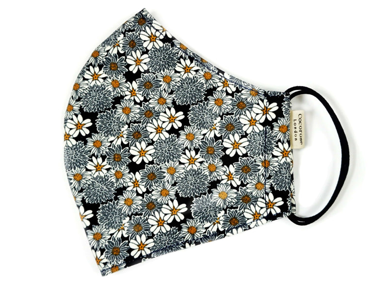 Quality face covering with pretty daisy flower print, filter pocket and adjustable elastic loops