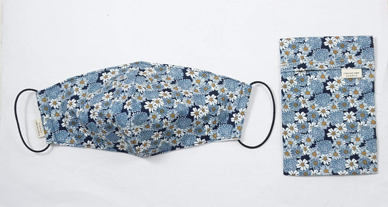 Pretty and stylish face mask with daisy floral print in navy, blue and white