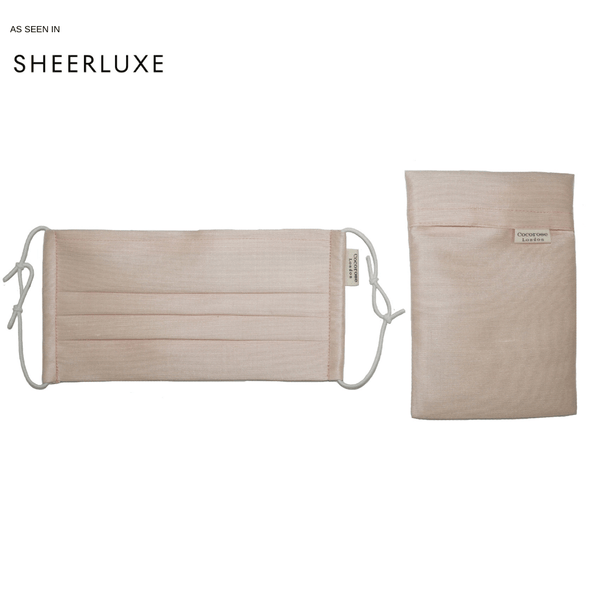 Silk lined and silk pleated face mask and face covering in peach pink as seen in sheerluxe