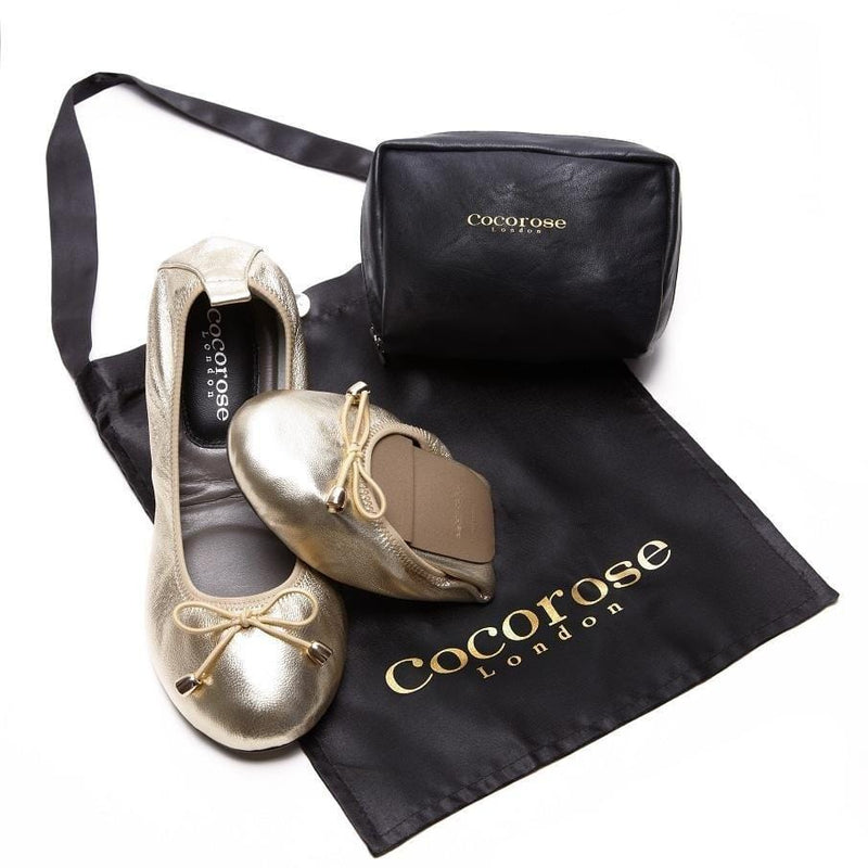 Image of Gold Leather Shoes and Purse