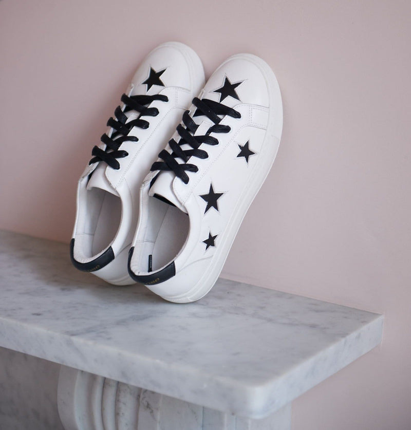 Comfortable fashion trainers | White leather sneakers with black stars