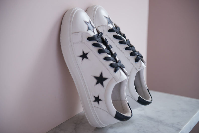 White leather trainers with black stars | women's designer trainers | the most comfortable sneakers