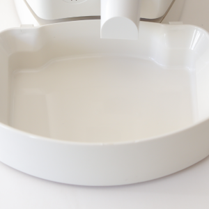 High angle photo of the Pet Feedster detachable bowl. Off-white, cream colored, made of food grade ABS plastic and dishwasher safe. This bowl is sturdy and wide enough for large dogs and small cats alike.