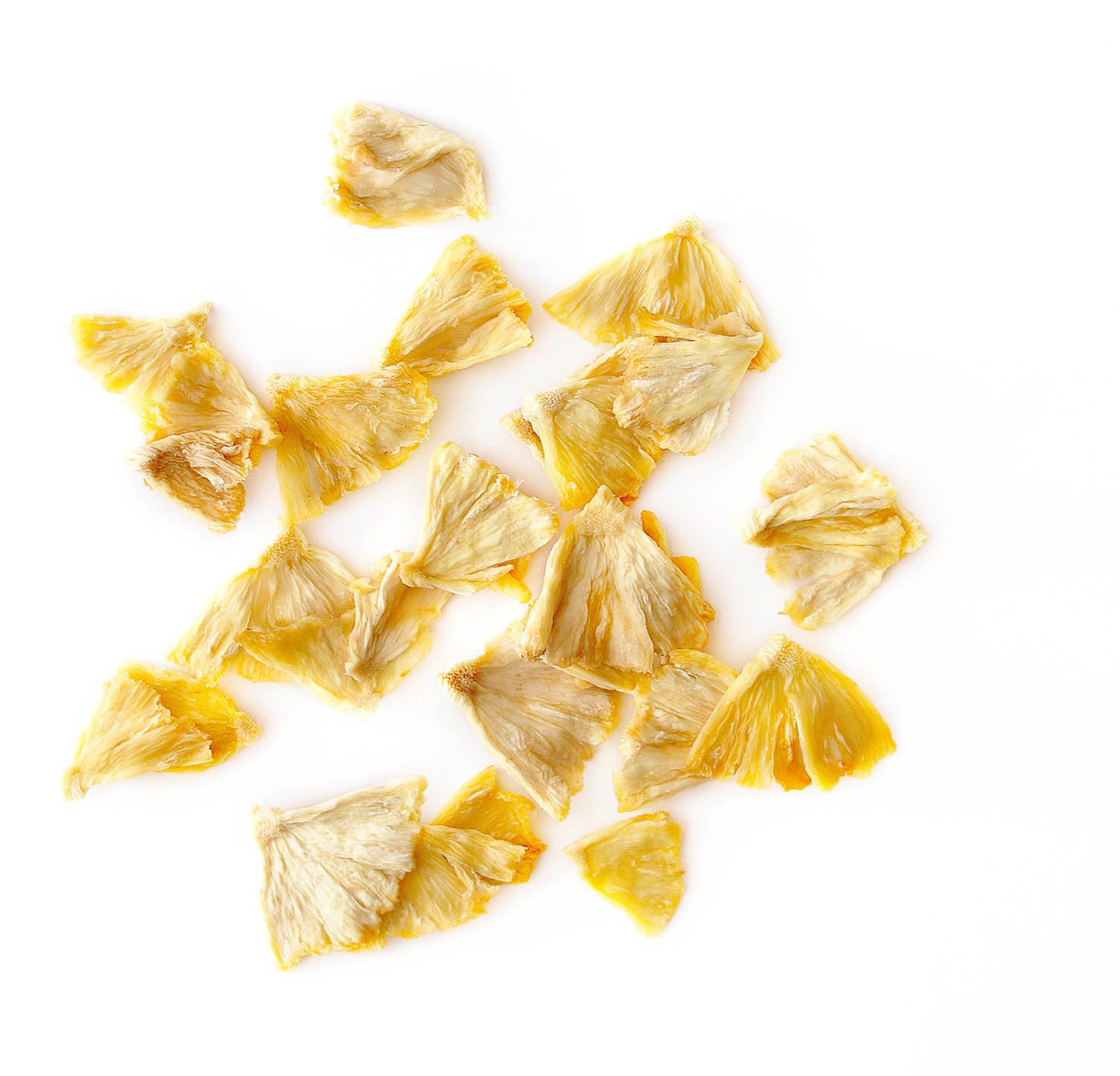 Healthy dried pineapple pieces spread out on a white background