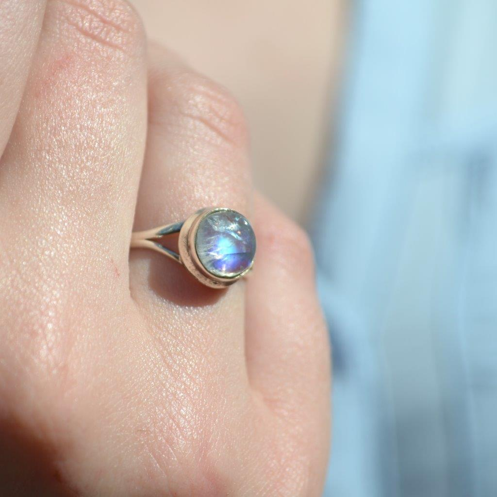 Round rainbow moonstone sterling silver ring on hand from Forevergems Franschhoek South Africa