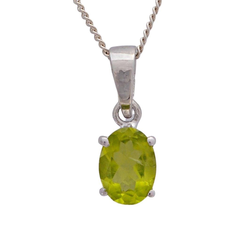 Green peridot faceted oval gemstone in 4 claw  sterling silver setting