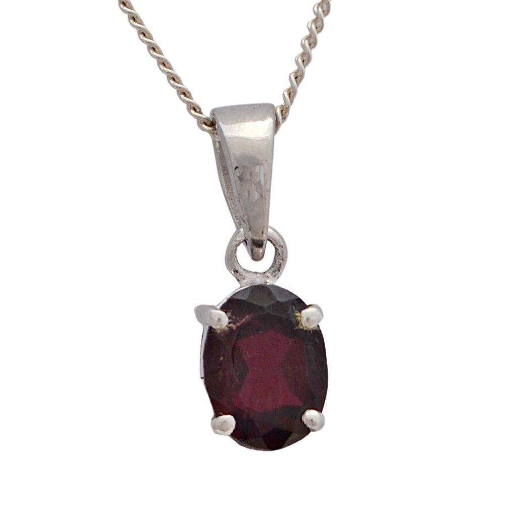 Faceted red garnet set in sterling silver 4 claw settiing