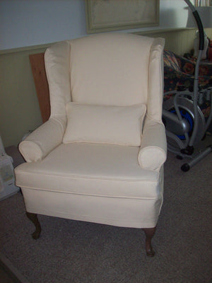 Wing chair with piping and no skirt