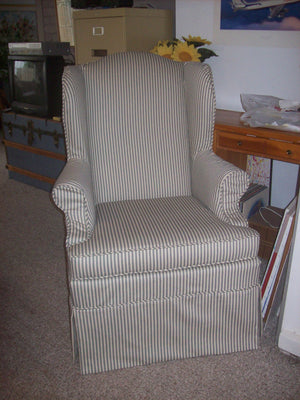 Wing chair with piping and skirt
