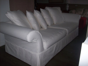 Multi-cushion sofa. Piped & skirted.
