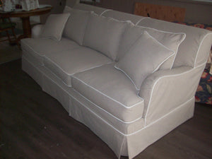 Sofa with contrasting piping. Skirted.
