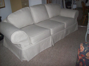 6 cushion sofa. Piped & skirted.