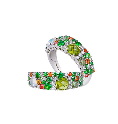 Heralding spring, and the lushest of tropical forests, emerald and light green stones dance across an elegant carpet of gemstones