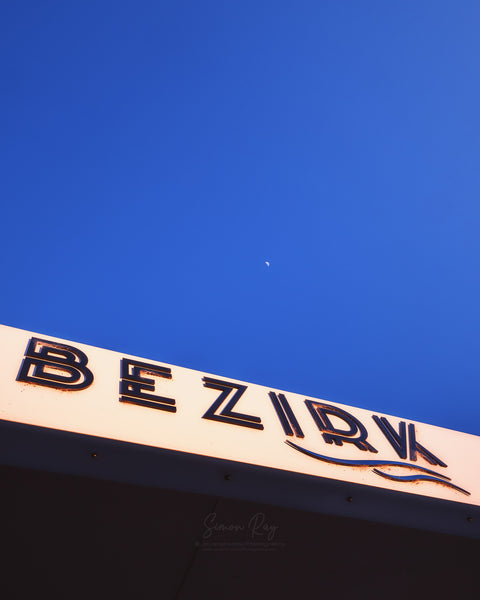 Bezirk Cafe sign with moon in sky