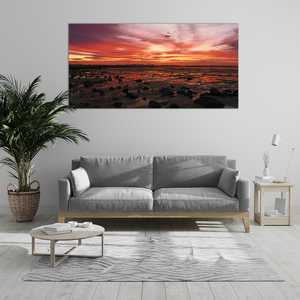 Example of how the photo will look on a loungeroom wall. Fiery red sunrise over the Melbourne skyline during low tide at Altona Dog Beach. Australian Landscape Photography.