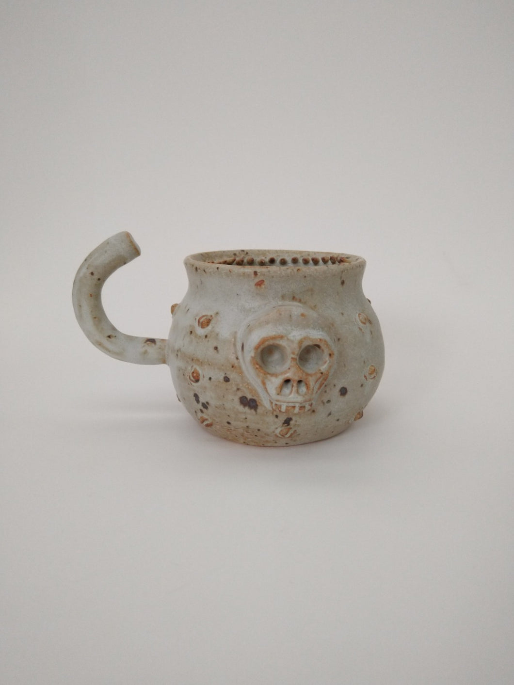 Toothed Ivory Hook Mug with Skull