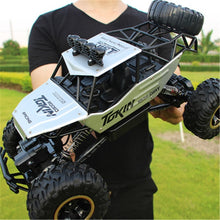 Load image into Gallery viewer, 1:12 4WD RC Cars Updated Version 2.4G Radio Control RC Cars Toys Buggy 2017 High speed Trucks Off-Road Trucks Toys for Children