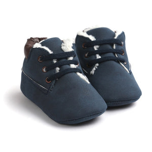 Leather, lace-up crib shoes.