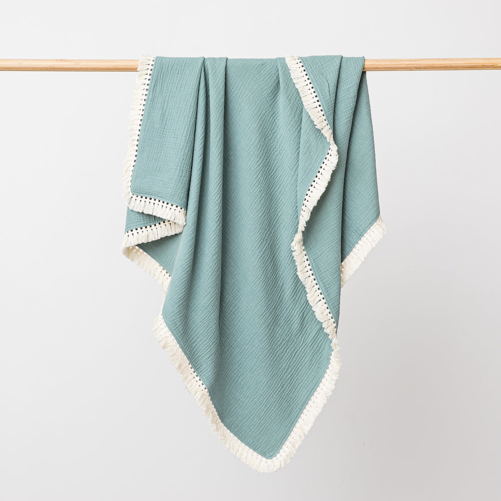 Organic cotton muslin baby blanket with tassel fringe in sage green