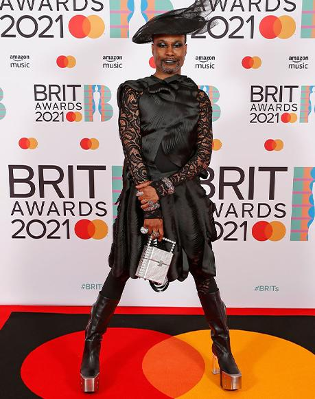 Actor Billy Porter with L'alingi silver cube clutch at the Brit awards 2021
