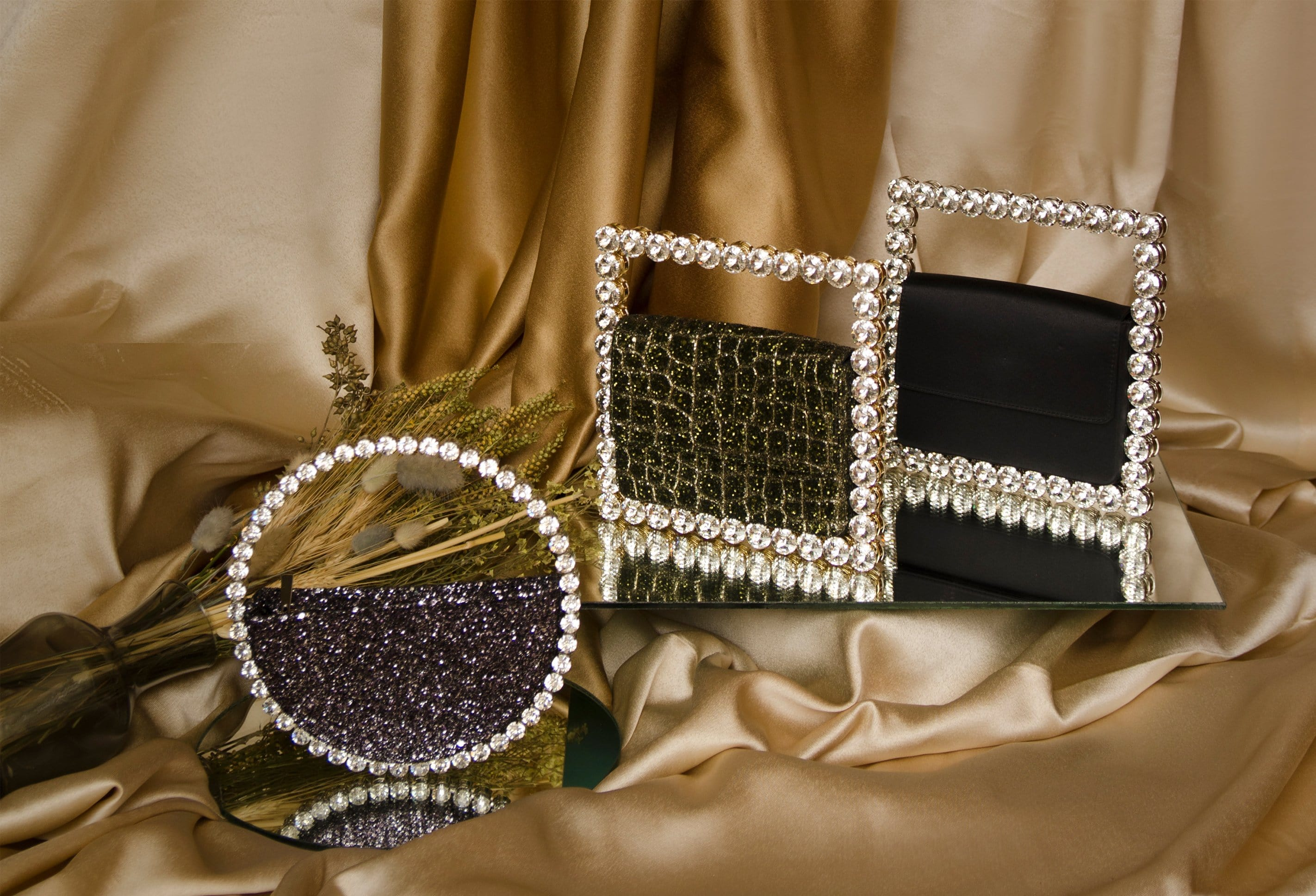 L'alingi London Autumn-Winter 2020 Lookbook cover with 3 crystal embellished evening clutches