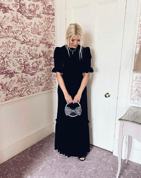 TV Presenter Holly Willoughby with L'alingi black bow eternity clutch