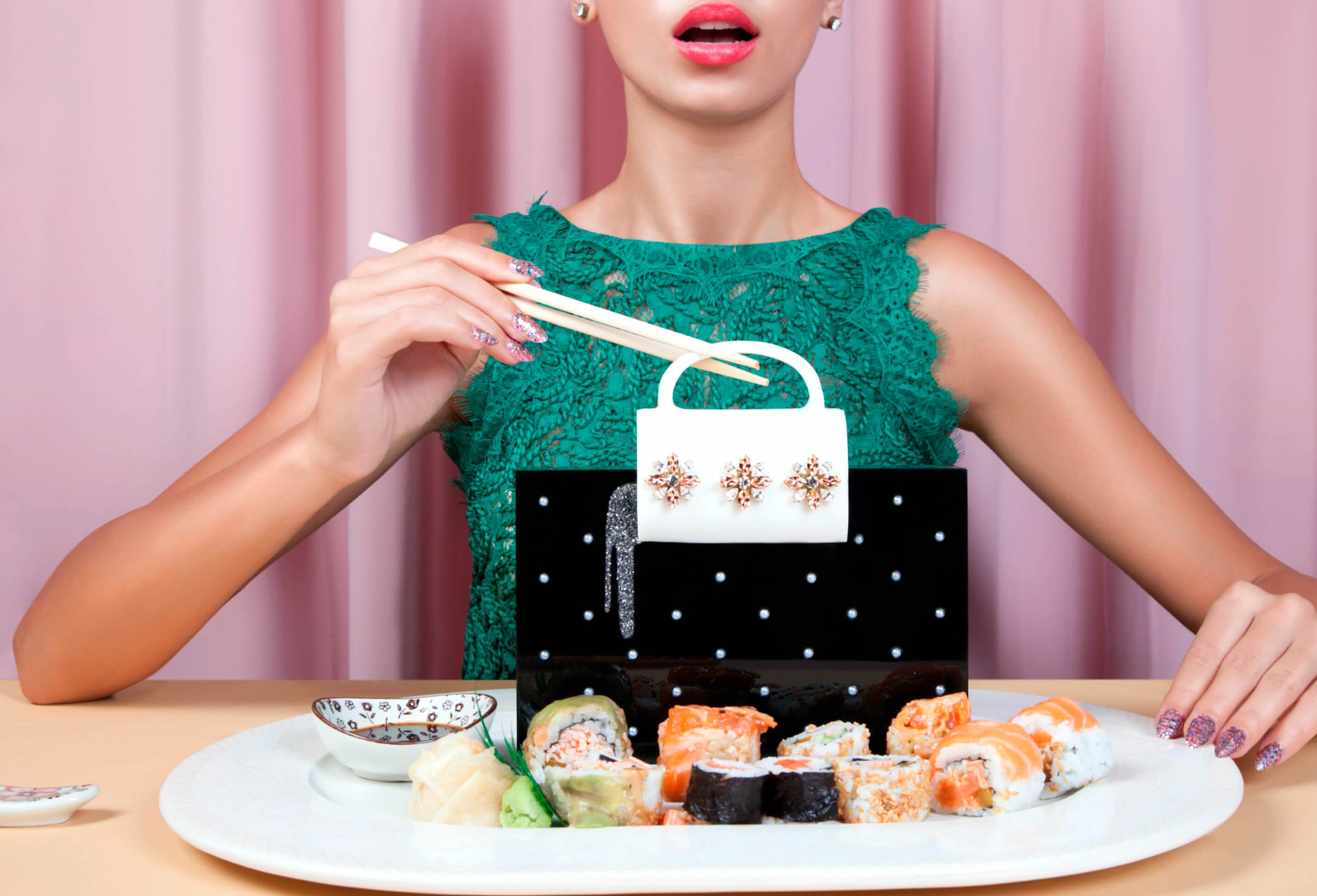 L'alingi London Spring-Summer 2018 Lookbook cover with Salma box clutch surrounded by sushi pieces