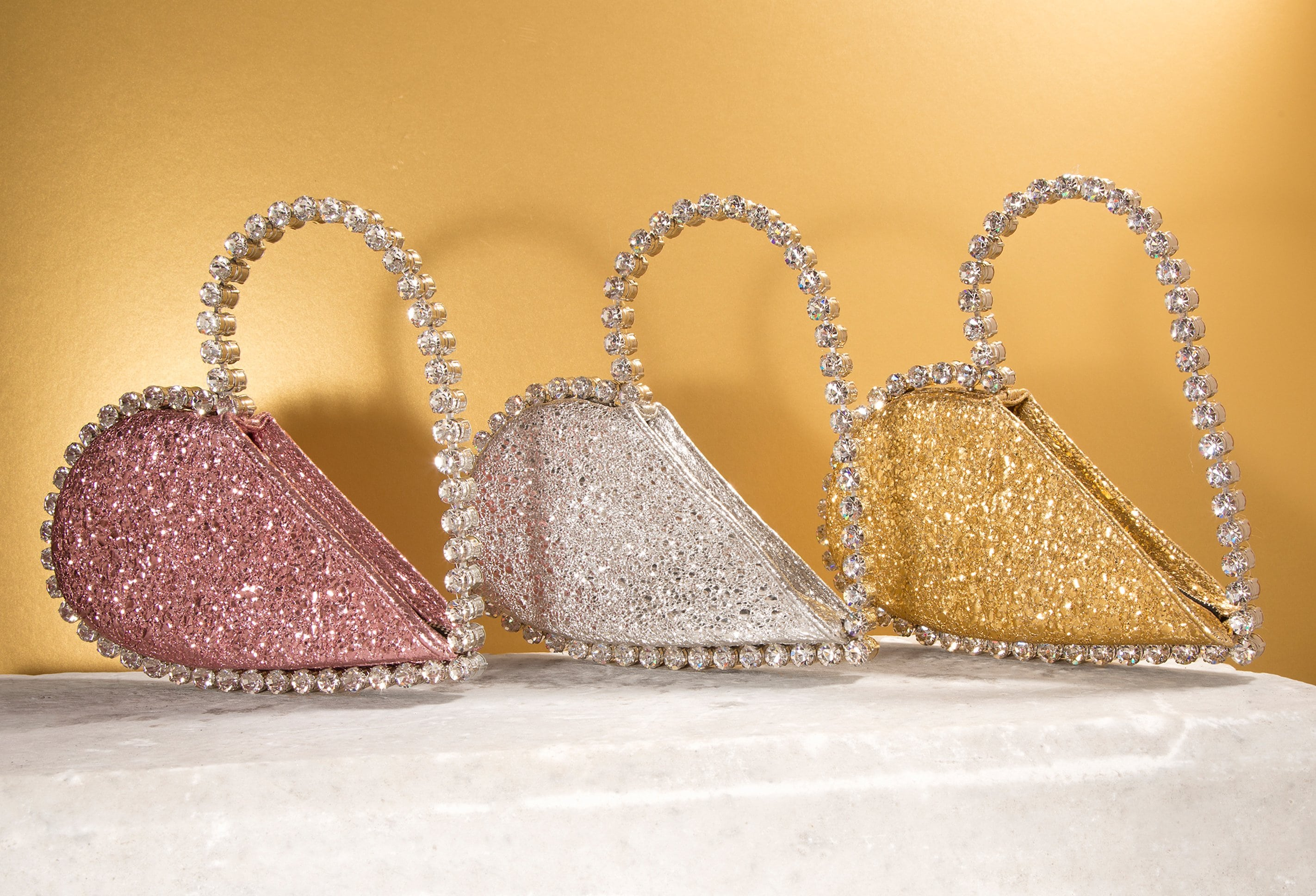 L'alingi London Spring-Summer 2021 Lookbook cover with 3 metallic heart shaped clutches