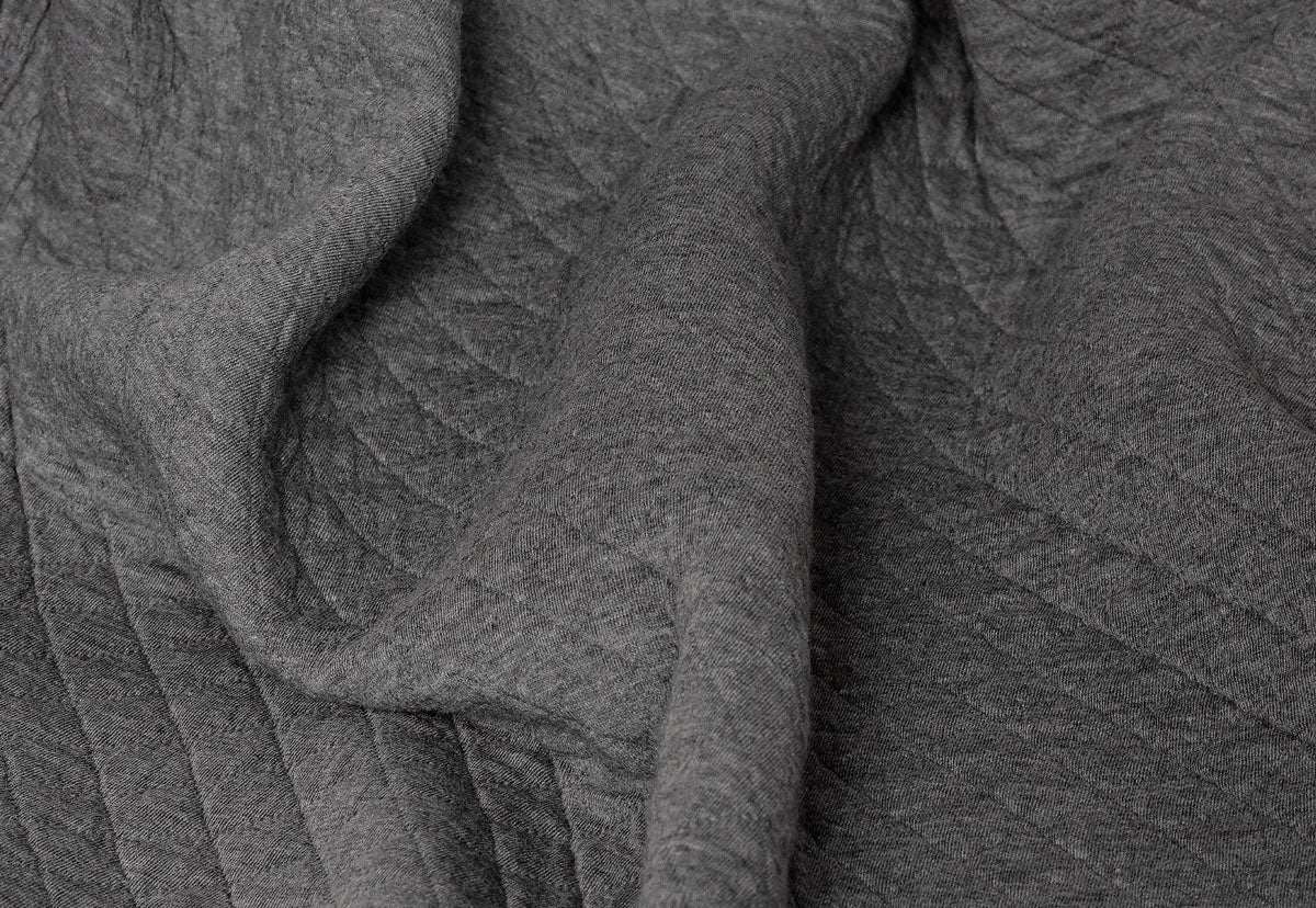 close-up view showing the cross-weave construction of curfew's CBD-infused dream blanket
