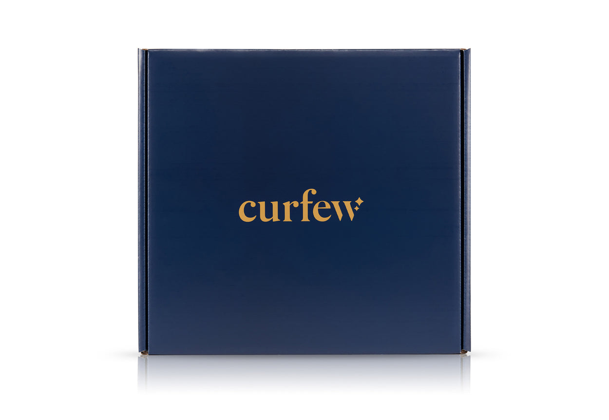 straight-on view of the curfew dream blanket box, showing the curfew logo