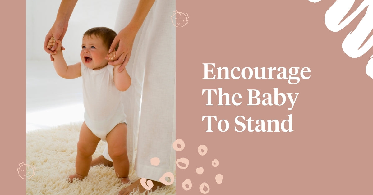 Encourage the baby to stand