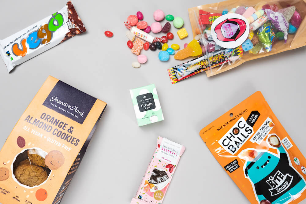 Vegan sweets flat-lay for the 20 best vegan gifts in Australia gift guide