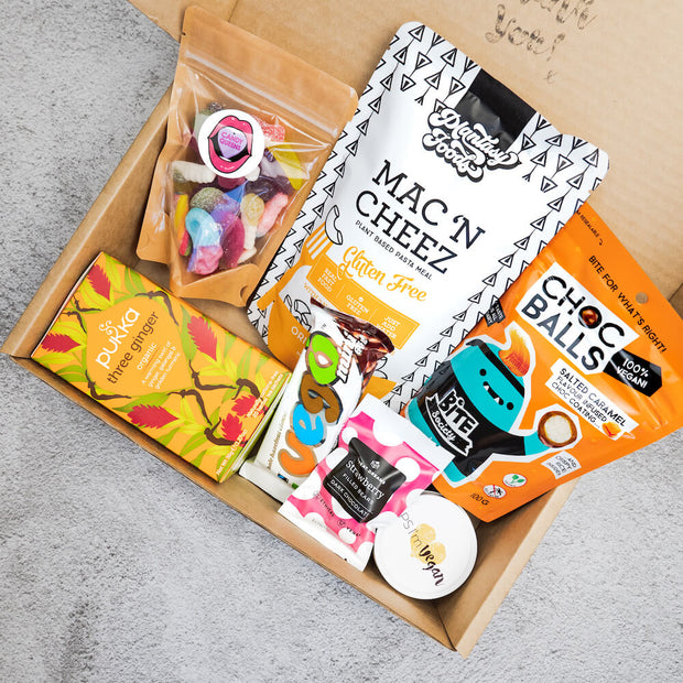 Contents of our Best Birthday Ever Box - Vegan Gift Hamper includes Vegan Maltesers, Vegan gel lollies, vegan chocolate bar, vegan mac and cheese, vegan candle, vegan candy, and vegan chocolate bears
