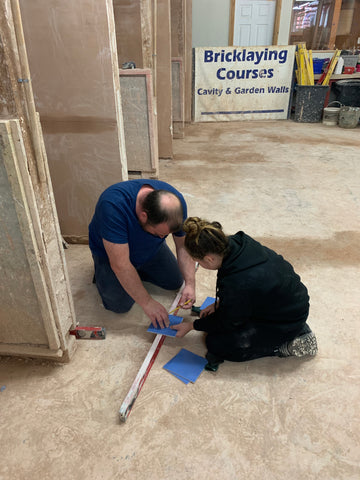Dad and daughter tiling