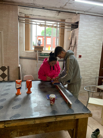 Mum and son tiling