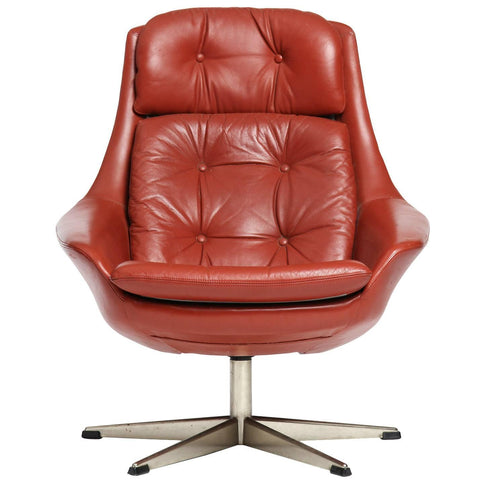 Red leather swivel armchair by H.W. Klein