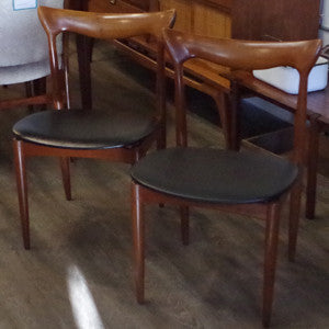 H.W. Klein teak dining chairs with original leatherette seats from Vintage Home Boutique