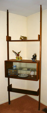 Reff freestanding teak wall unit. Image from Tribute Decor.