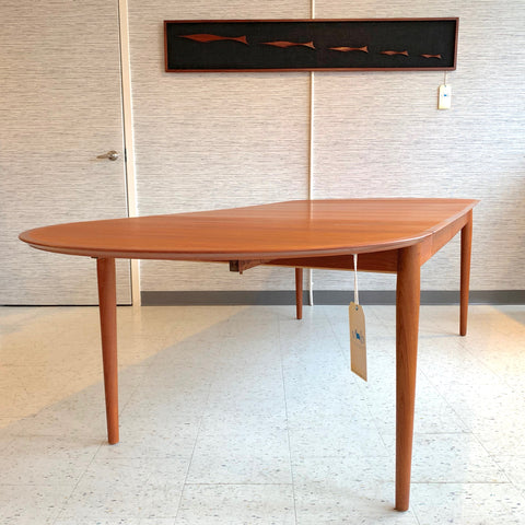 Danish Modern Oval Extending Teak Dining Table By Arne Vodder