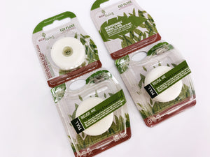 Two boxes of Eco friendly vegan mint dental floss in bio plastic packaging dispenser