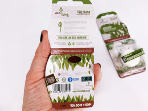 Image of back of eco friendly vegan mint dental floss in bio plastic packaging dispenser