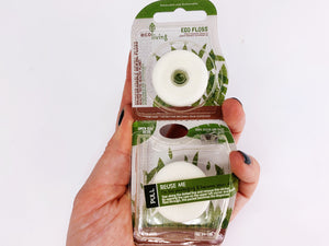 Eco friendly vegan mint dental floss in bio plastic packaging dispenser