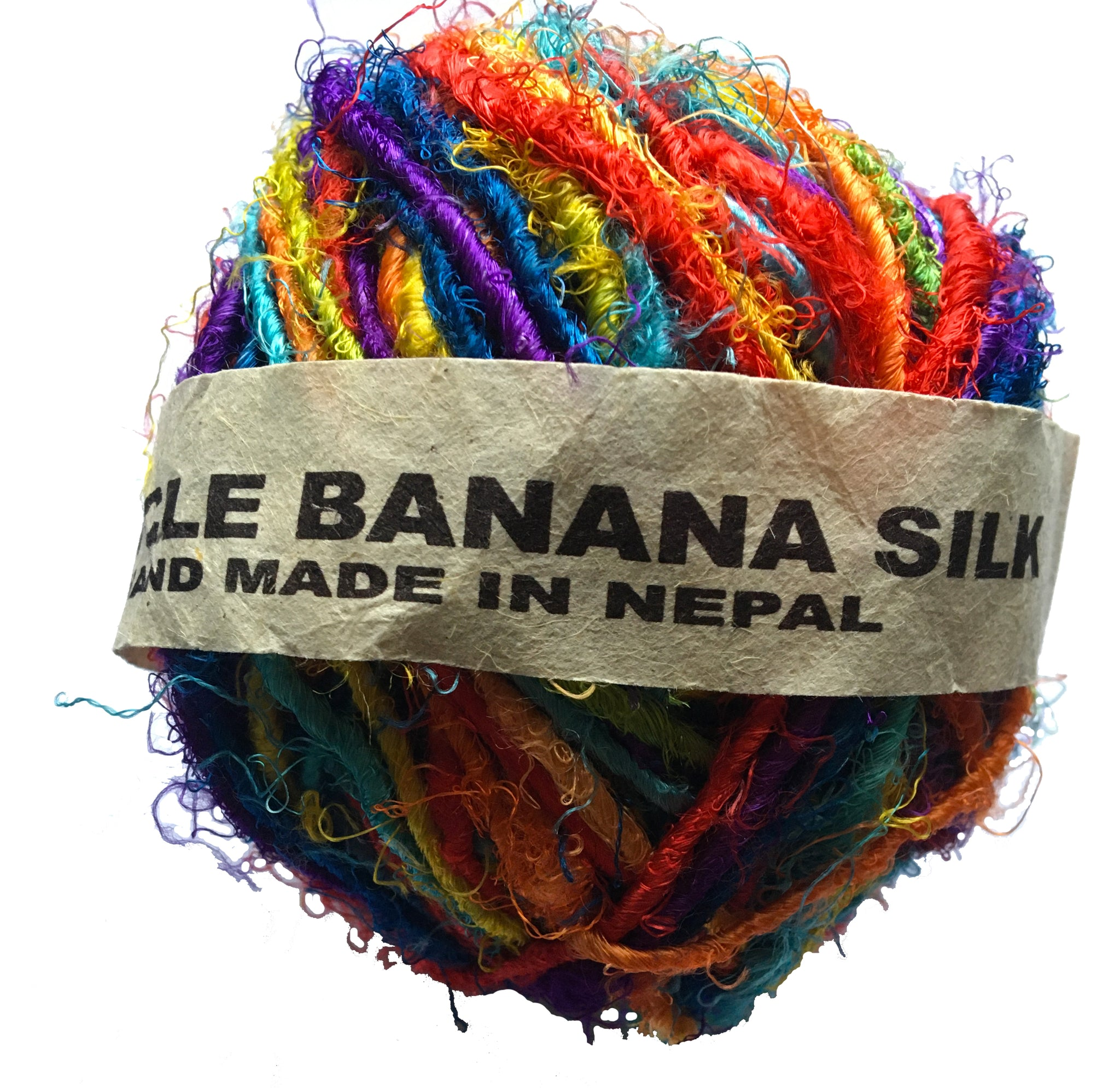 A ball of fair trade recycled banana silk yarn in vibrant rainbow colours wrapped in a paper label.