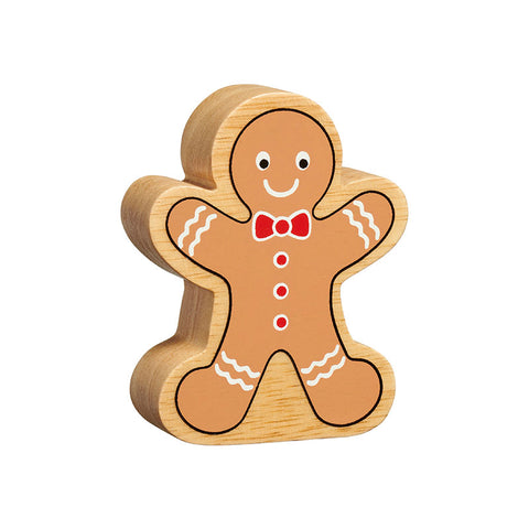 A gingerbread man figure handpainted on chunky natural wood with the grain showing. It is brown with white icing decoration and red buttons and bow tie
