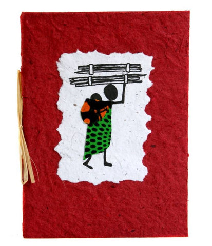 An eco friendly and fair trade greeting card with a black line drawing of an African woman wearing a brightly coloured print dress carrying firewood on her head and carrying a baby on her back in a colourful sling. The picture is on white handmade paper with irregular edges stuck on red card tied with twine