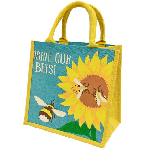 Fair trade eco-friendly jute bag in bright yellow  with a pattern of screen printed blue sky, a yellow and brown sunflower and 3 brown, yellow and white bees. The writing on the bag says 'save our bees'