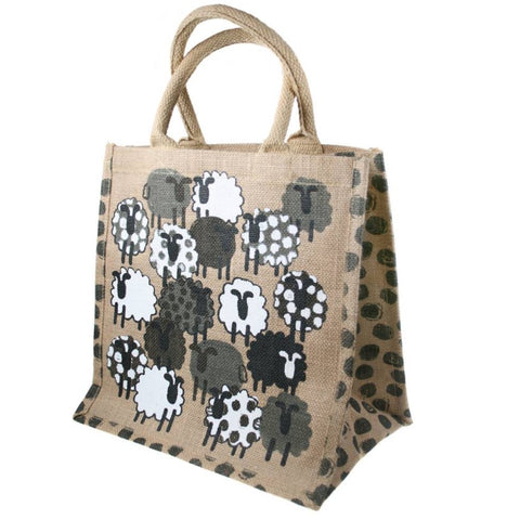 Fair trade eco-friendly jute bag in natural colour with a pattern of screen printed white, black and grey sheep